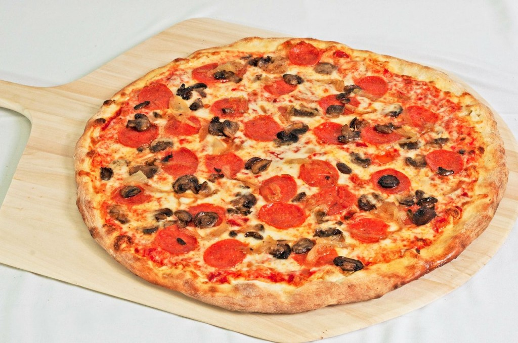 Pizza topped with mozzarella, mushrooms, onions, and pepperoni
