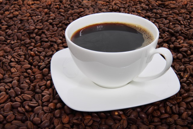 coffee on a bed of coffee beans